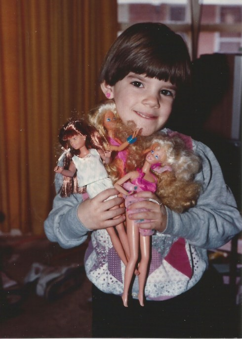 I did play with my dolls, but I never used marker or scissors on them!!!