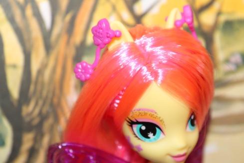 Deluxe Fluttershy, showing off her ears with earrings