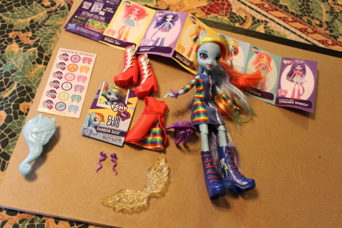 Rainbow Dash (who I forgot to photograph after this point) with her multiple accessories.
